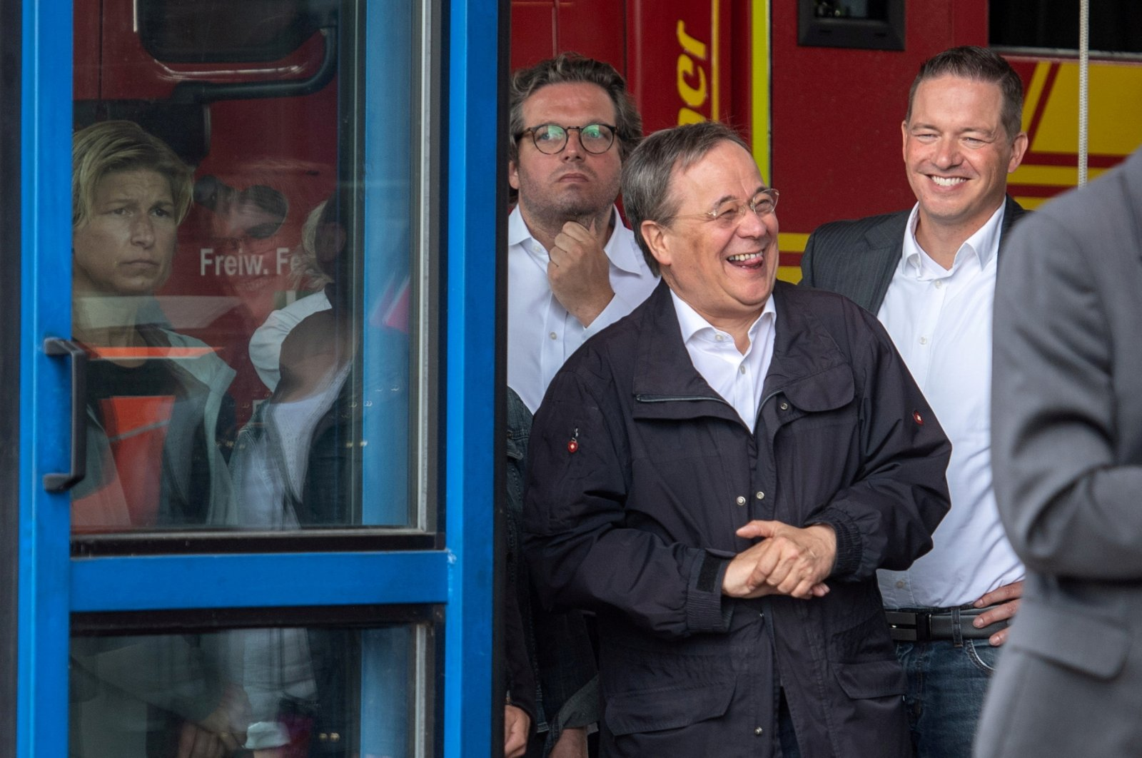 CDU leader and North Rhine-Westphalia's State Premier Armin Laschet laughs as the German president (unseen) delivers a speech during their visit to flood-hit Erftstadt, Germany July 17, 2021. (Marius Becker/Pool/File Photo)