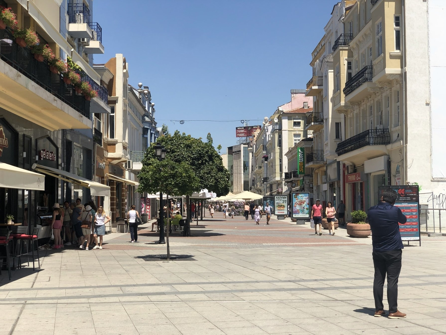 People take a walk on the relatively empty avenues of Filibe, Bulgaria.
