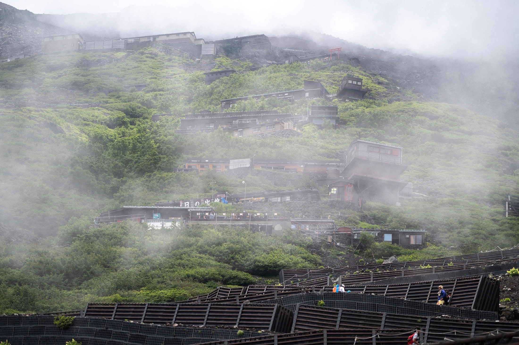 People hike to the summit of Mount Fuji, some 70 kilometers (43 miles) west of the capital Tokyo, Japan, July 18, 2021. (AFP Photo)