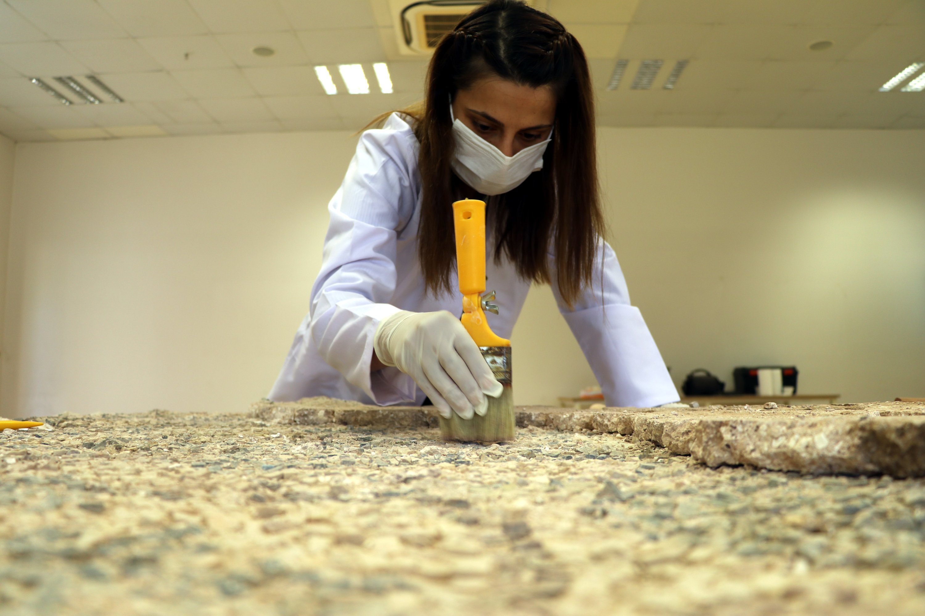 A restorer works on the mosaic in Hatay Archaeology Museum, Hatay, southern Turkey, July 25, 2021. (AA Photo)