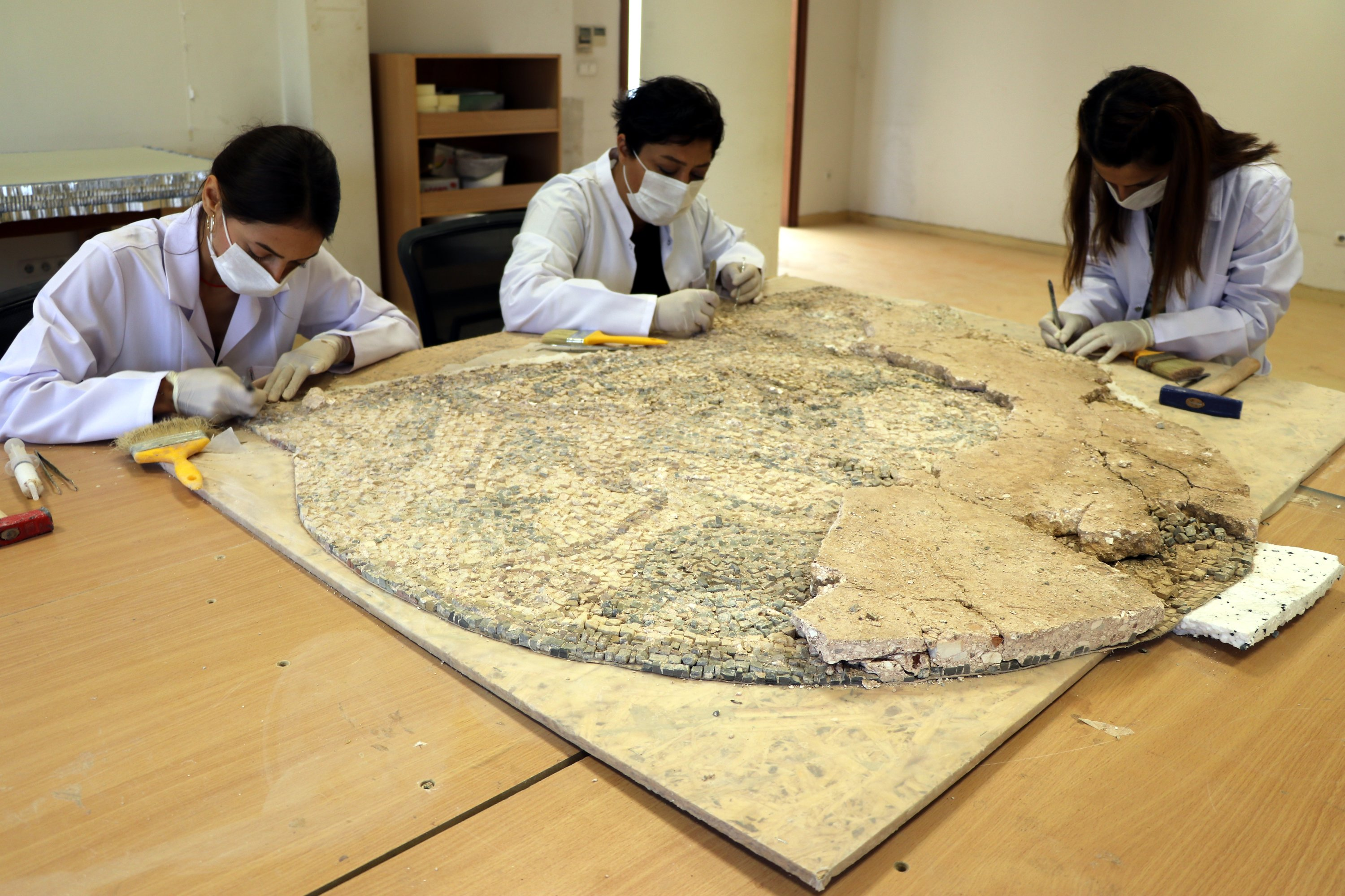 Restorers work on the mosaic in Hatay Archaeology Museum, Hatay, southern Turkey, July 25, 2021. (AA Photo)