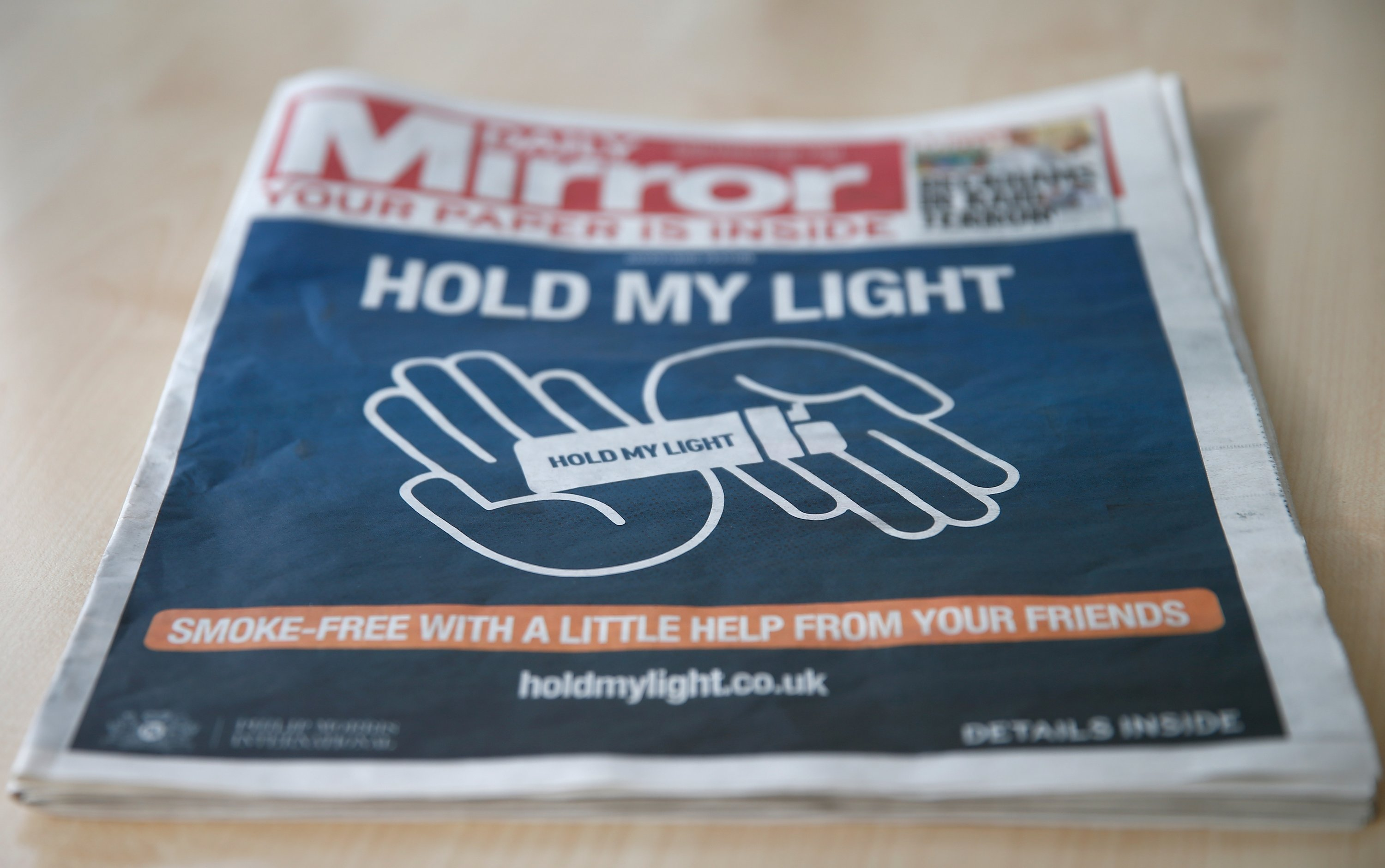 The front of a four page wraparound advertisement by Philip Morris calling on people to quit smoking for 30 days is seen on the front page of the Daily Mirror in London, U.K., Oct. 22, 2018. (Reuters Photo)