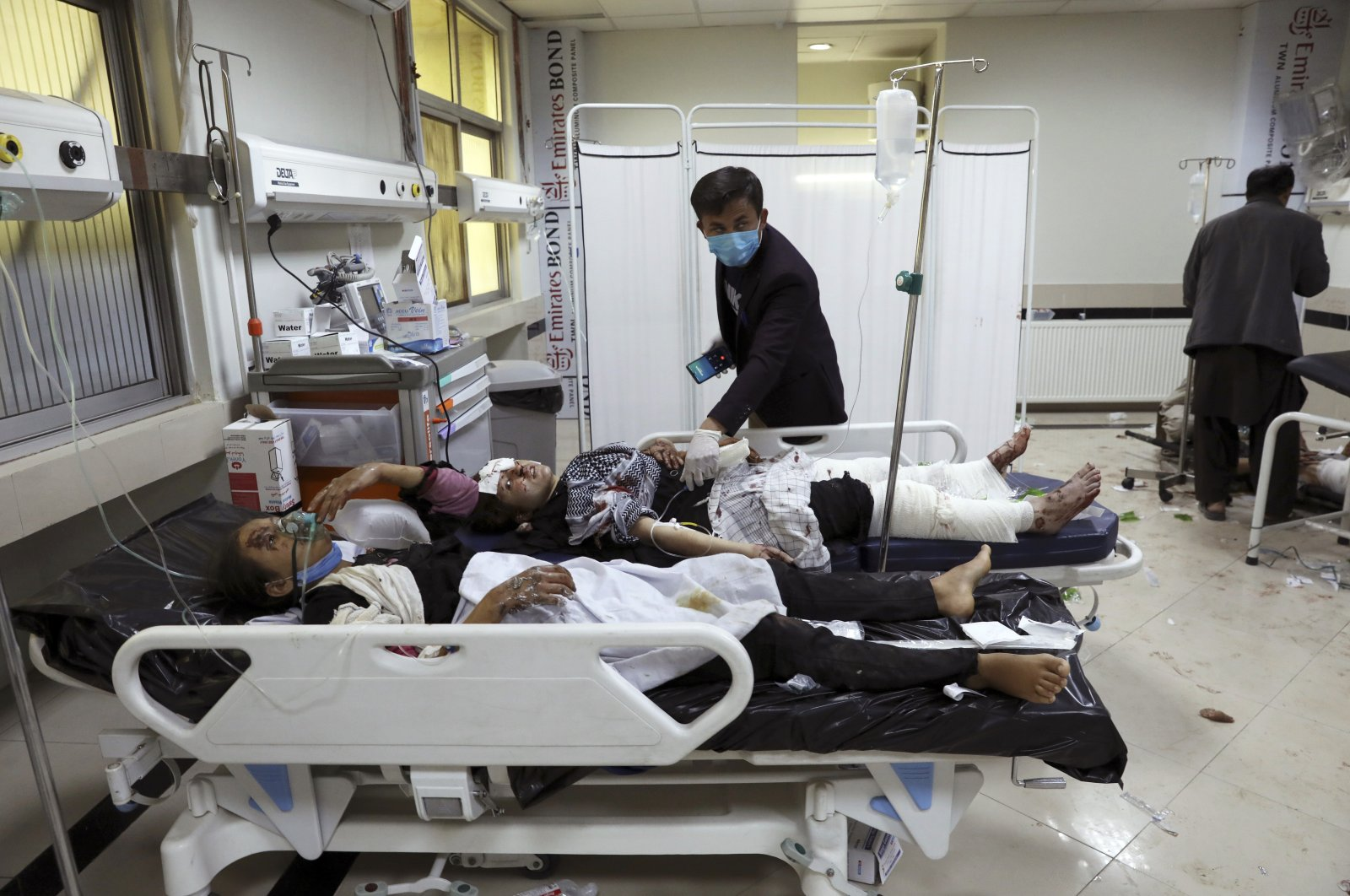 Afghan school students are treated at a hospital after a bomb explosion near a school in western Kabul, Afghanistan, May 8, 2021. (AP Photo)