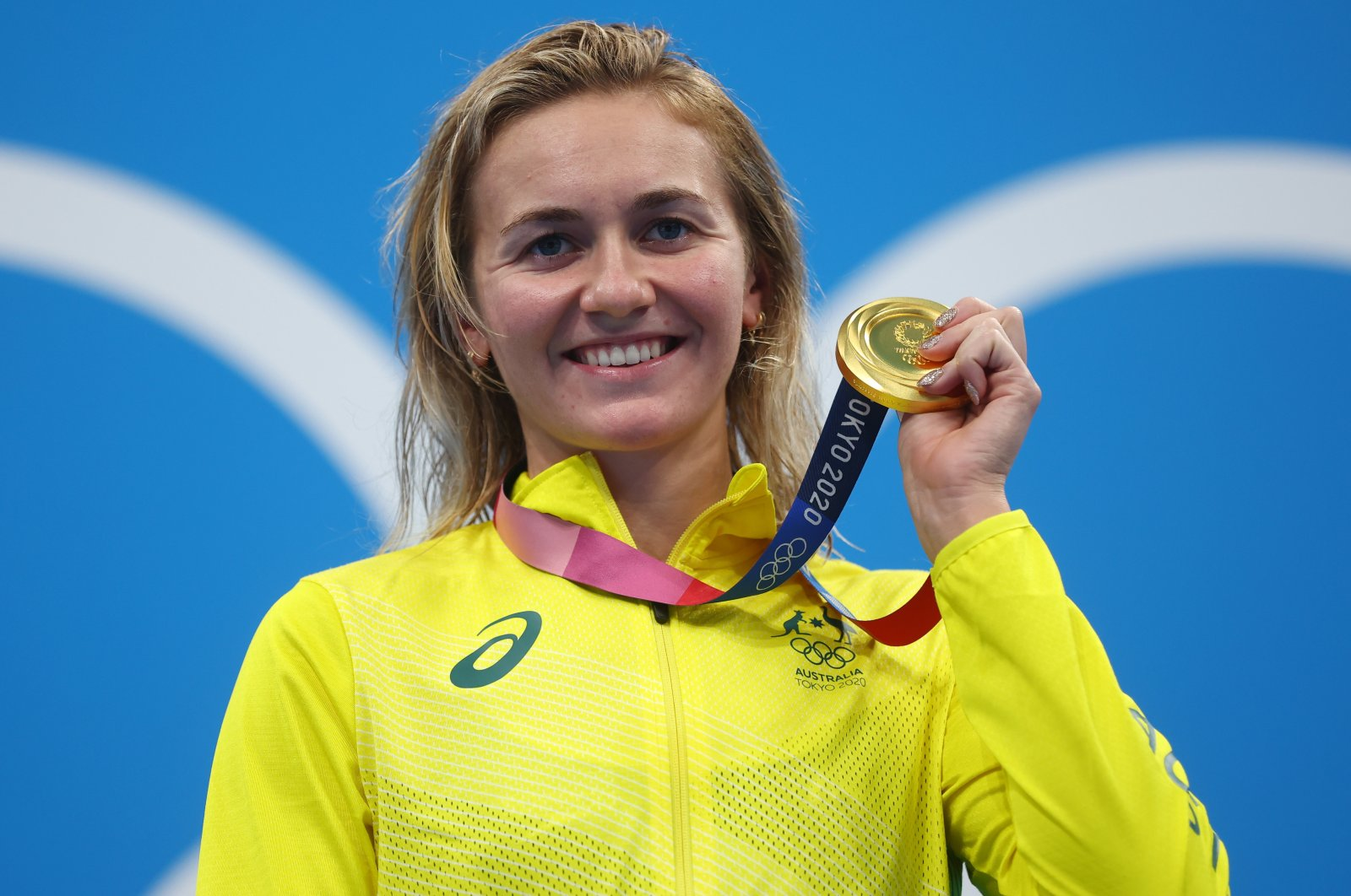 Australia's Ariarne Titmus poses with the 400-meter freestyle Tokyo 2020 Olympics gold medal at the Tokyo Aquatics Centre, Tokyo, Japan, July 26, 2021.