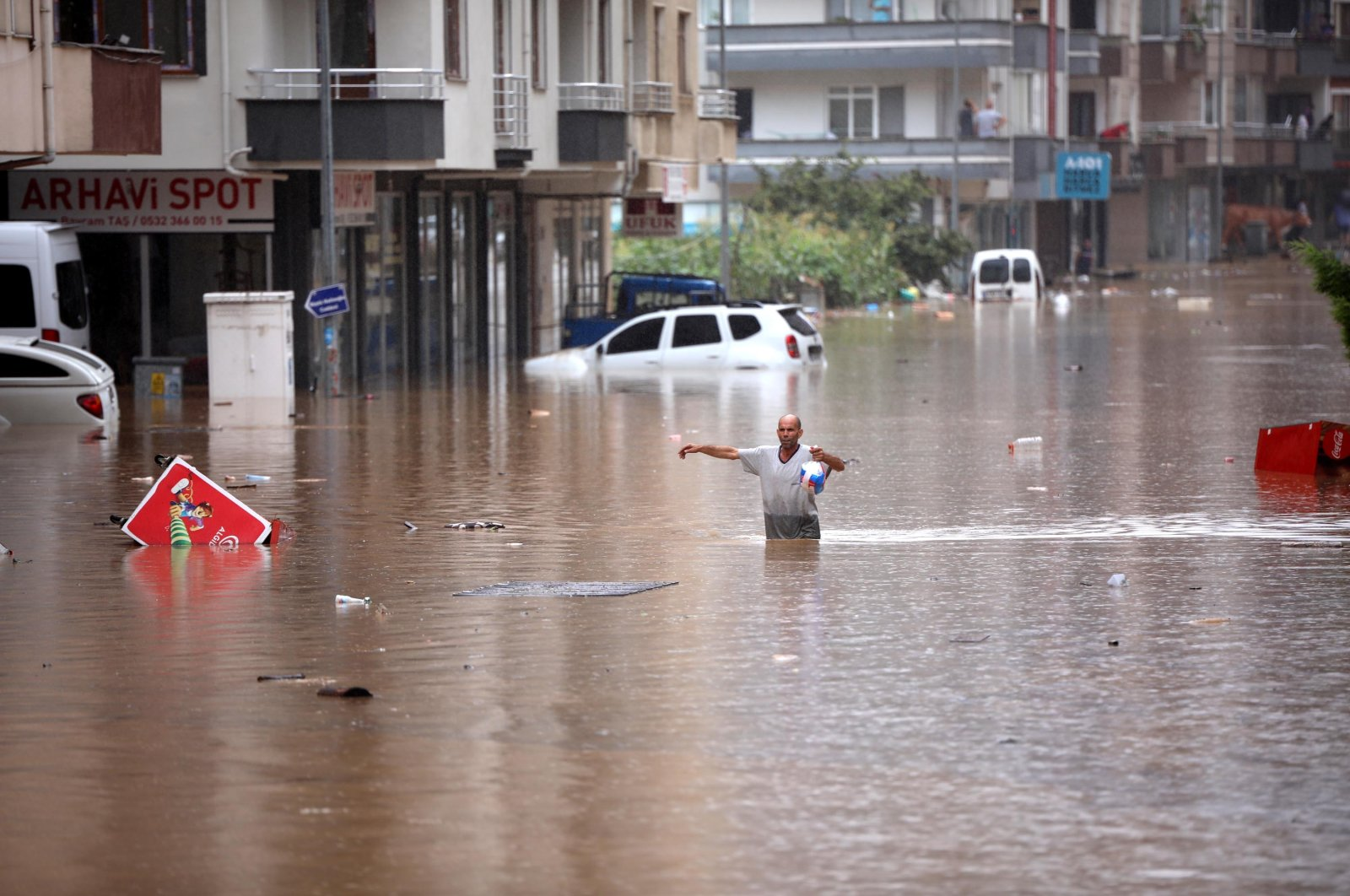 A man wades through a flooded street, in Arhavi district, in Artvin, northeastern Turkey, July 22, 2021. (DHA PHOTO)