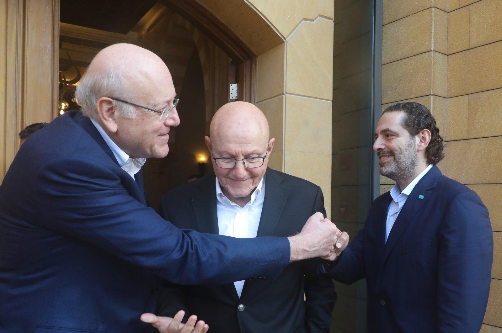 Lebanese former prime ministers, Saad Hariri and Najib Mikati greet each other in Beirut, Lebanon, July 25, 2021. (Reuters Photo)