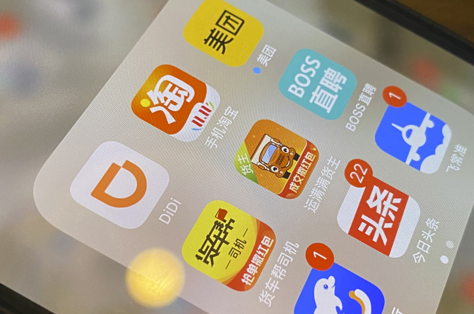 The ride-hailing app Didi is seen near other Chinese apps on a phone in Beijing, China, Monday, July 5, 2021. (AP Photo)