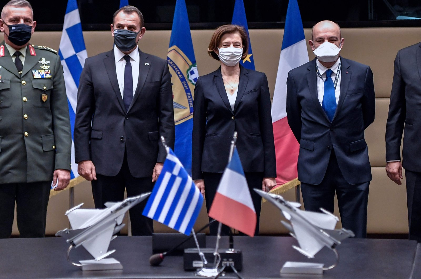 (L-R) Greek Chief of Staff General Konstantinos Floros, Defence Minister Nikolaos Panagiotopoulos, French Defence Minister Florence Parly and GIFAS (French Aerospace Industries Association) Chairperson and Dassault Aviation Chief Executive Eric Trappier pose after the signing of the Rafale warplane deal, Athens, Greece, Jan. 25, 2021. (AFP Photo)