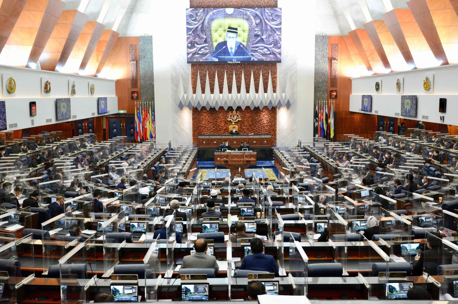 A special session of the Dewan Rakyat (House of Representatives) at the Parliament in Kuala Lumpur, convening for the first time since January after being suspended under a coronavirus emergency, July 26, 2021. (Photo by Nazri RAPAAI / Malaysia's Department of Information / AFP)