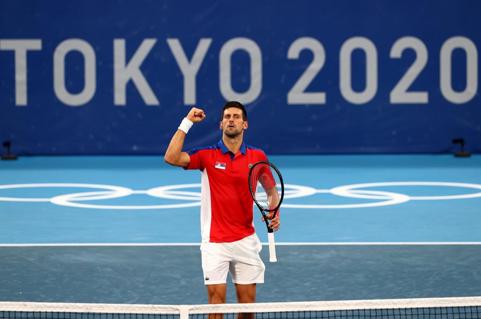Serbia's Novak Djokovic celebrates after winning his Tokyo 2020 Olympics Tennis Men's Singles second-round match against Germany's Jan-Lennard Struff, Ariake Tennis Park, Tokyo, Japan, July 26, 2021.