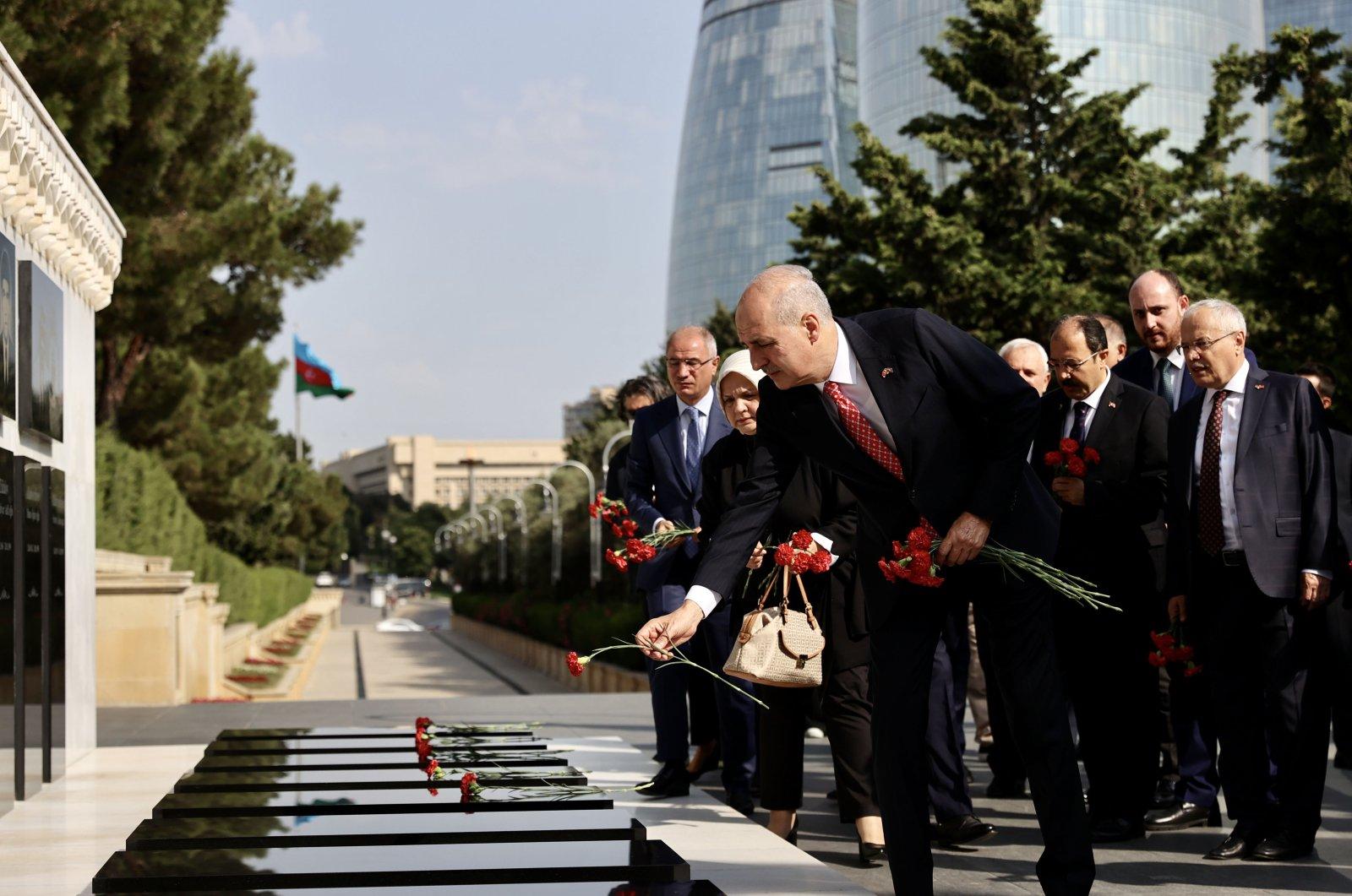 Turkey's ruling Justice and Development Party (AK Party) Deputy Chair Numan Kurtulmuş and his delegation visit the Baku Martyrs' Lane in the capital Baku, Azerbaijan, July 26, 2021. (AA Photo)