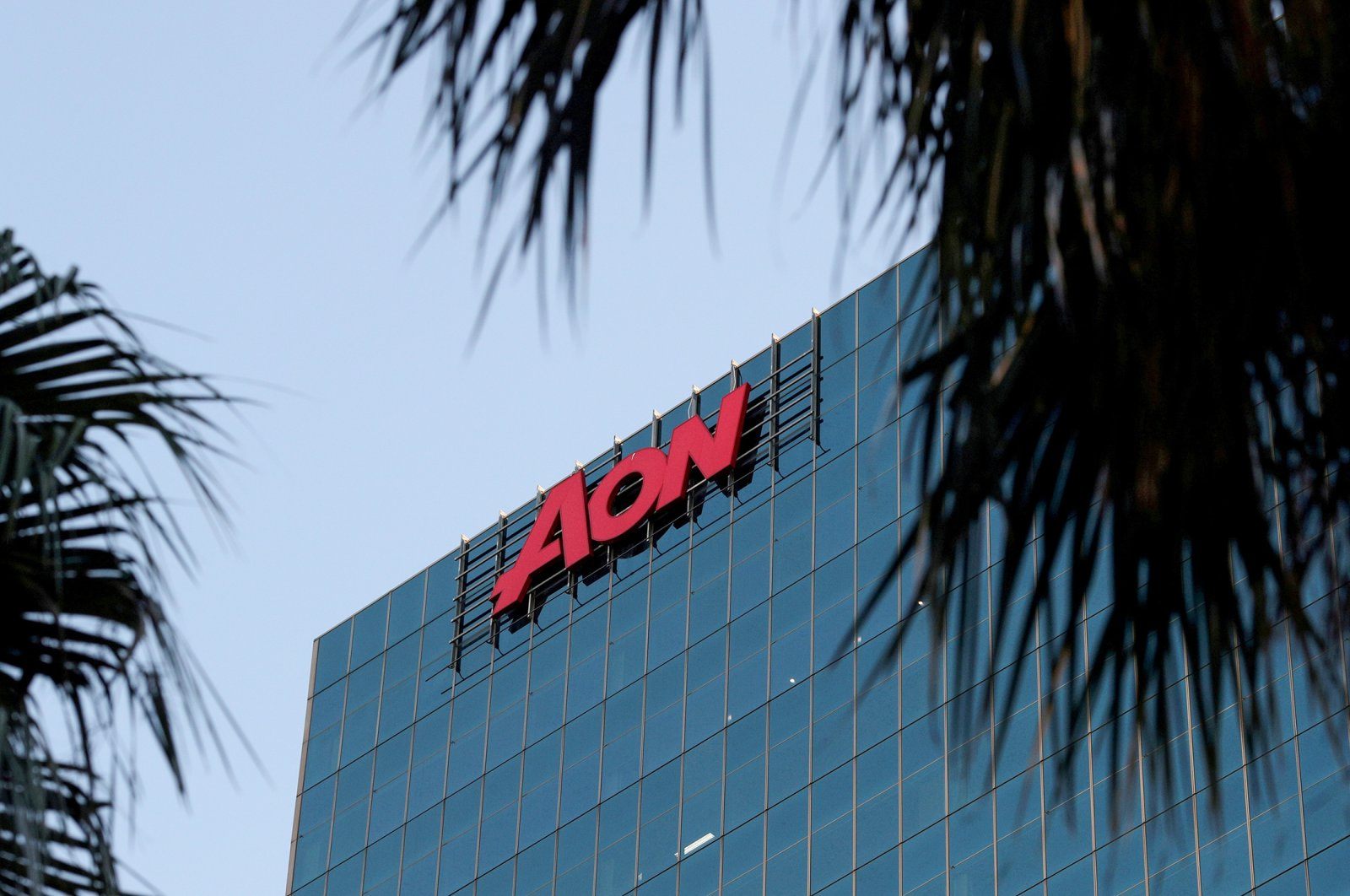 An office building with the Aon logo is seen in the Central Business District of Sydney, Australia, June 3, 2020. (Reuters Photo)