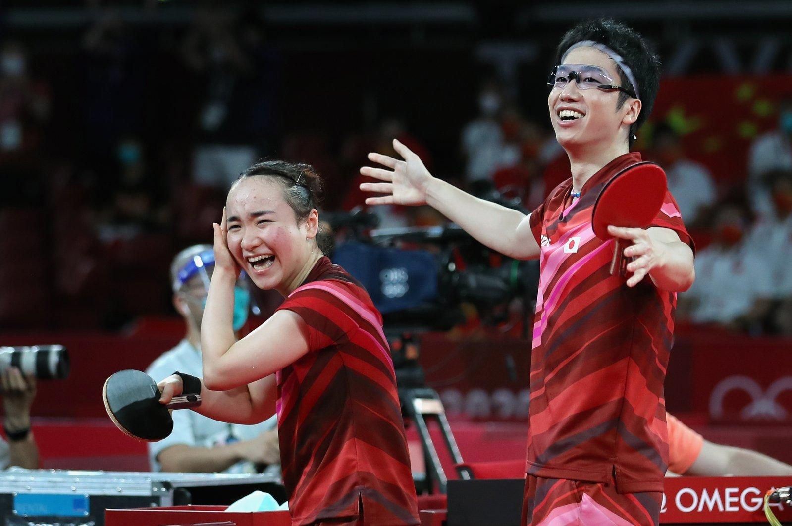 Japan's Jun Mizutani (R) and Mima Ito (L) reacts after winning Table Tennis Mixed Doubles gold medals at the Tokyo 2020 Olympic Games, Tokyo, Japan, July 26, 2021. (EPA Photo)