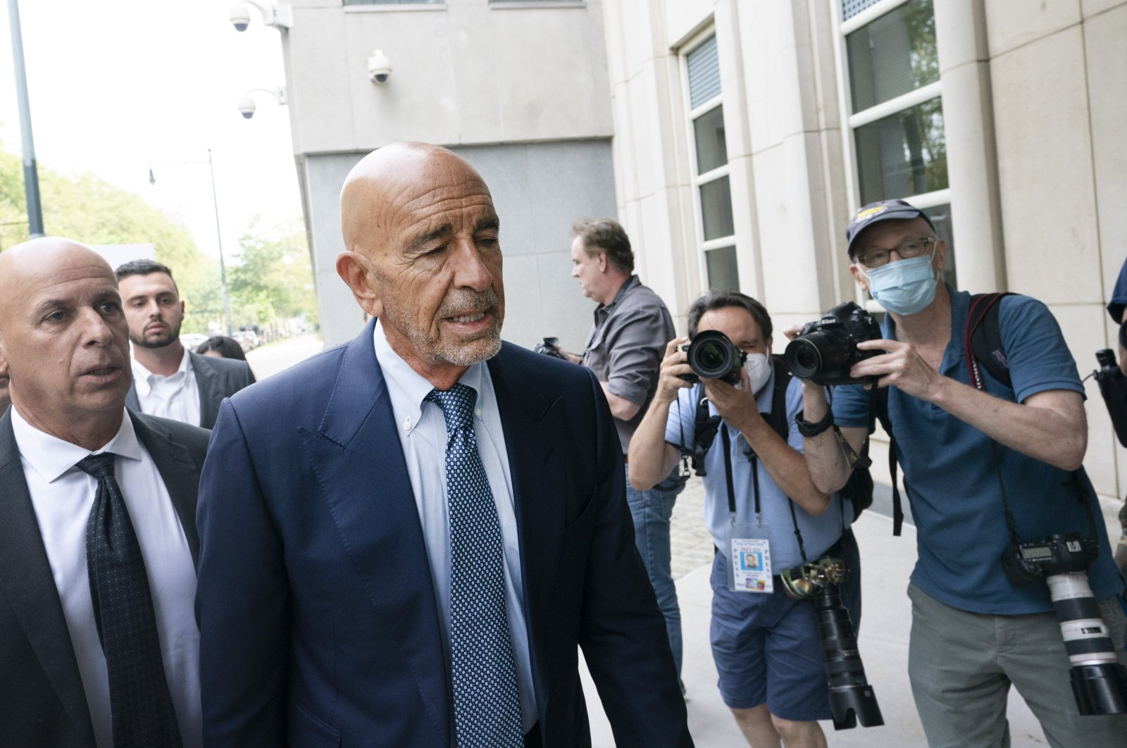 Tom Barrack (2L) arrives at Brooklyn federal court, in New York, July 26, 2021. (AP Photo)