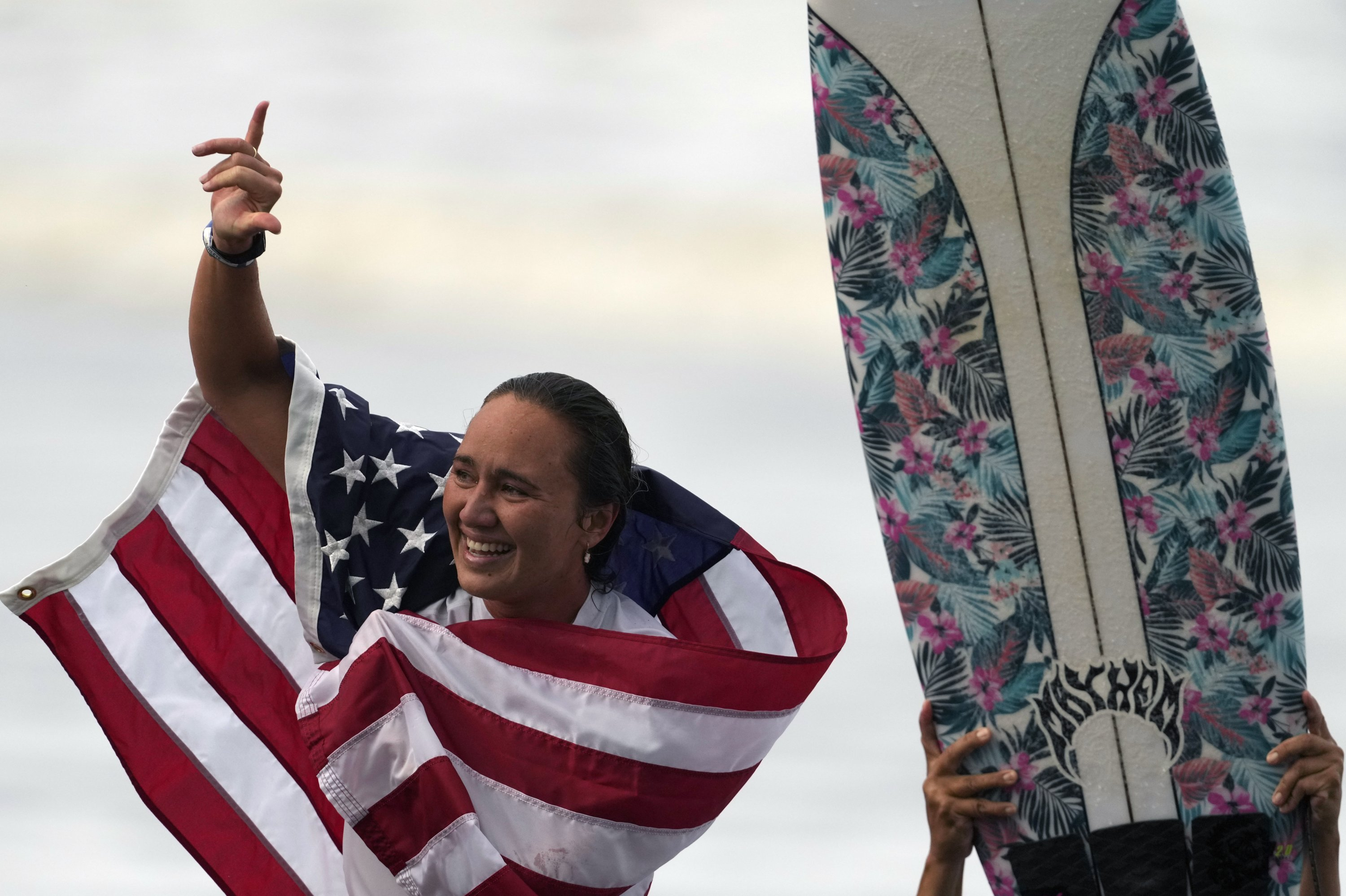 U.S.'s Carissa Moore celebrates winning the gold medal in the women's surfing competition at the 2020 Summer Olympics at Tsurigasaki Surfing Beach, Chiba, Japan, July 27, 2021. (AP Photo)
