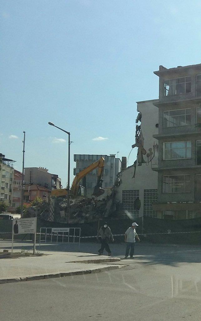 A bulldozer destroys the old city hall building in Burdur, Turkey, July 27, 2021. (Photo courtesy of Twitter user @Seda_Ozen)