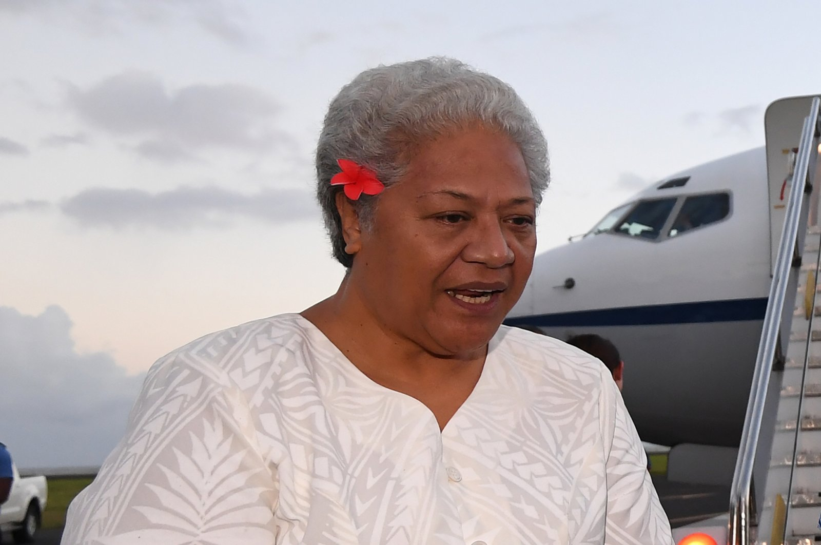Then Deputy Prime Minister of Samoa Fiame Naomi Mata'afa speaks with Australian Prime Minister Malcolm Turnbull and the Australian High Commissioner to Samoa Sue Langford as they arrive at Faleolo Airport in Apia, Samoa on Sept. 8, 2017. (AP Photo)