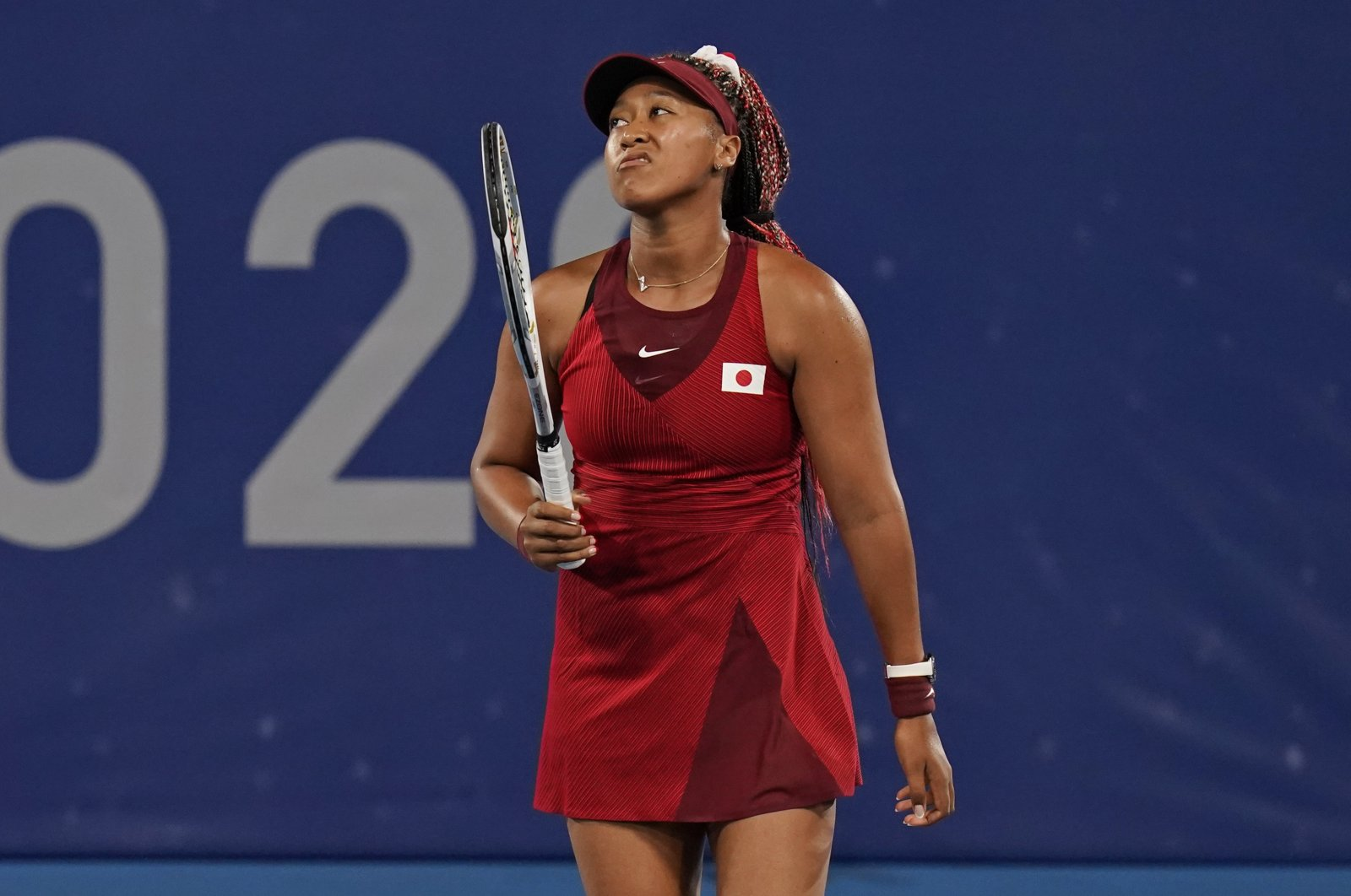 Naomi Osaka, of Japan, reacts after losing a point to Marketa Vondrousova, of the Czech Republic, during the third round of the tennis competition at the 2020 Summer Olympics, in Tokyo, Japan, July 27, 2021. (AP Photo)