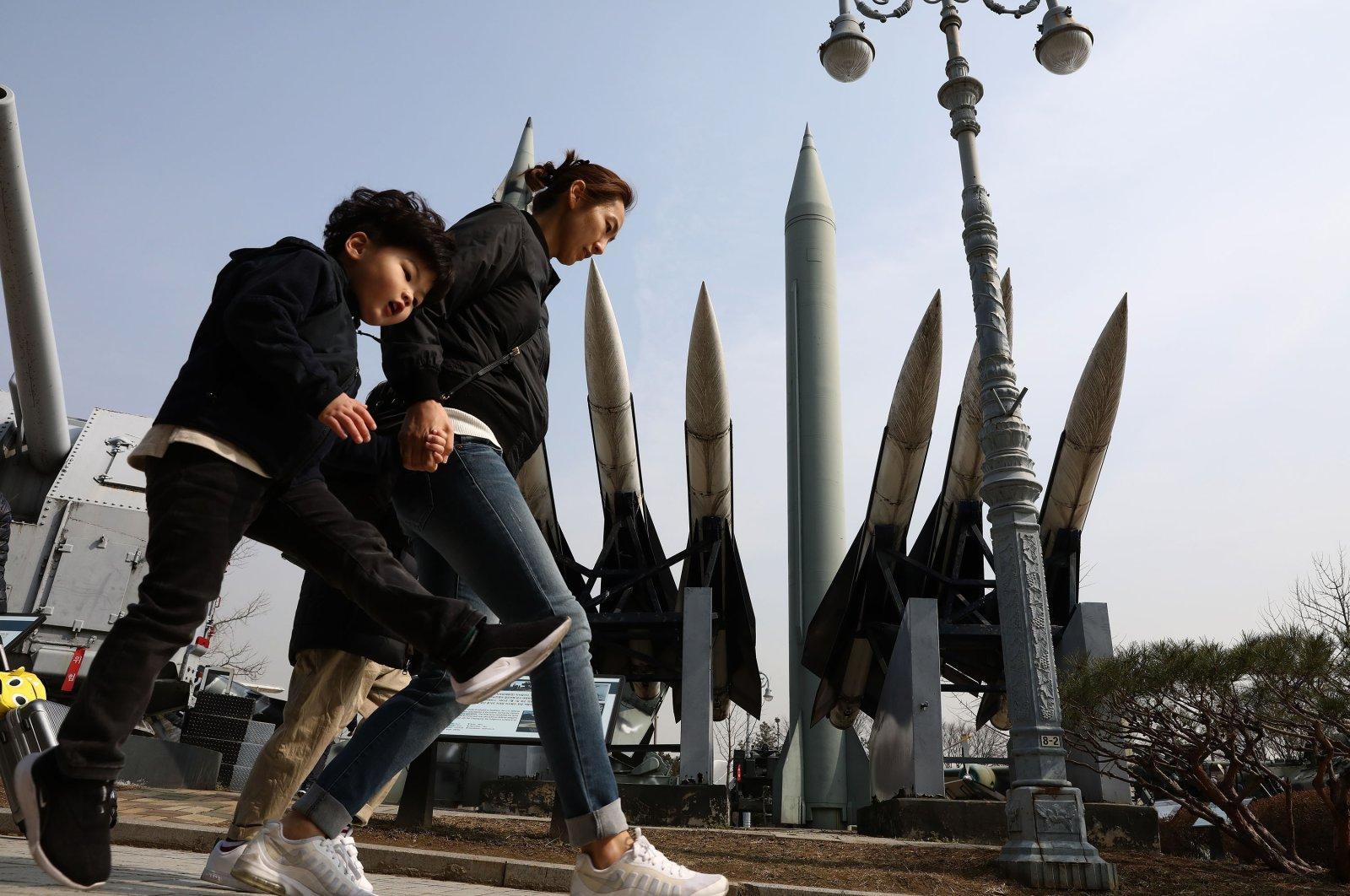 South Koreans walk past replicas of a North Korean Scud-B missile (C, back) and South Korean Nike missile (front) at the Korean War Memorial,  Seoul, South Korea, Feb. 28, 2019. (Getty Images)