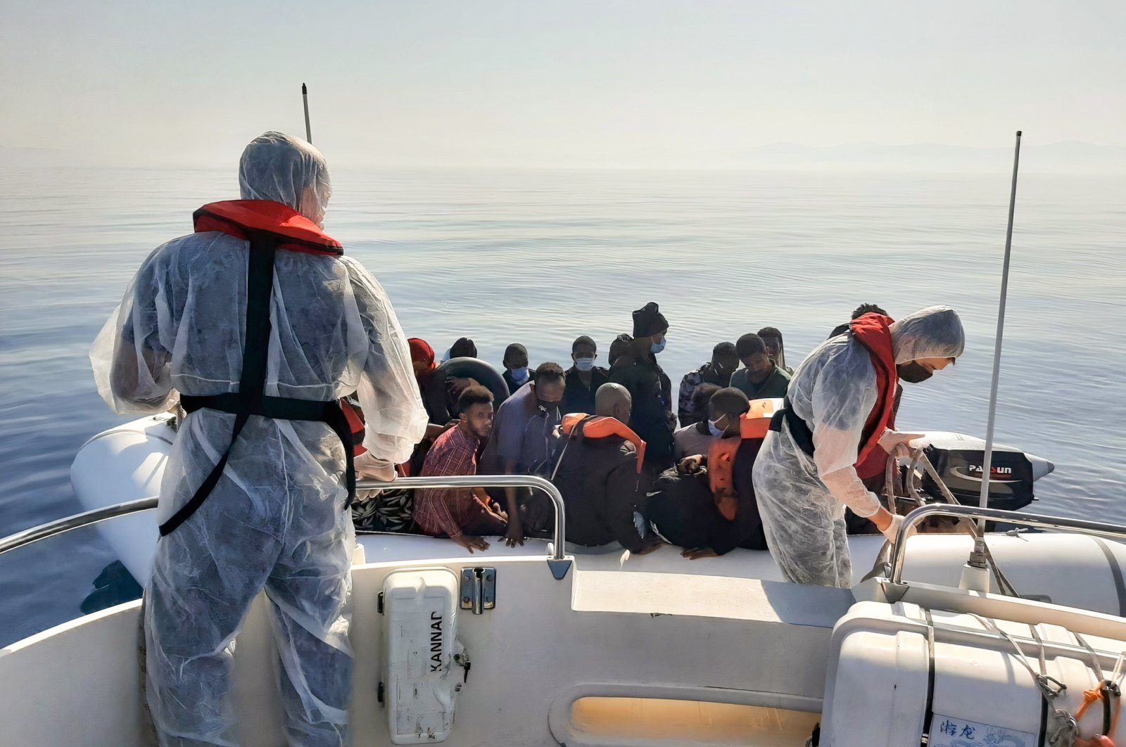 The Turkish coast guard saved 388 migrants pushed back by Greece off the coast of Izmir province, July 27, 2021 (AA Photo)