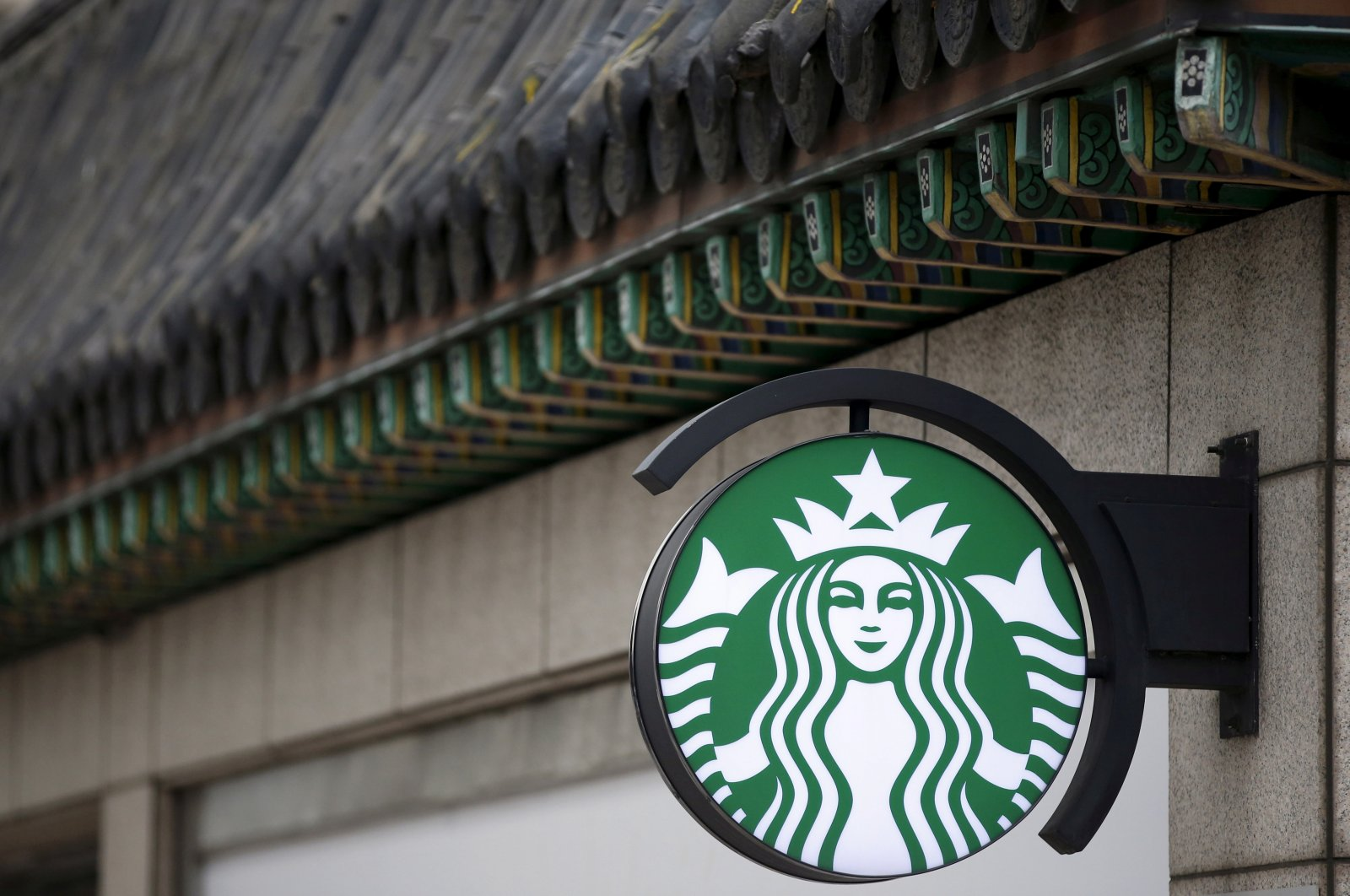 A Starbucks logo is seen at a Starbucks coffee shop in Seoul, South Korea, March 7, 2016. (Reuters Photo)
