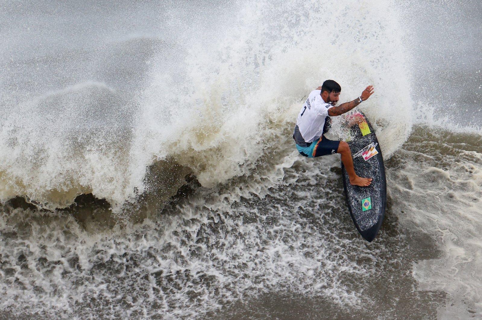 Brazil's Italo Ferreira in action during the Tokyo 2020 Olympics Men's Shortboard Surfing gold medal match at Tsurigasaki Surfing Beach, Chiba, Japan, July 27, 2021.