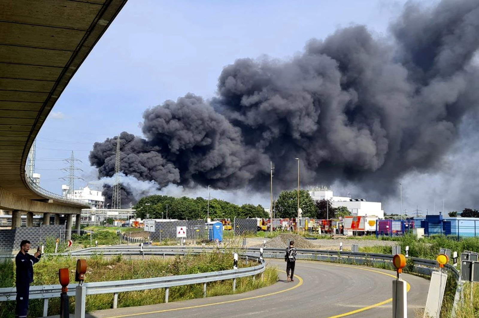 A dark cloud of smoke rises above the chemical park in Leverkusen, Germany, July 27, 2021. (AP Photo)