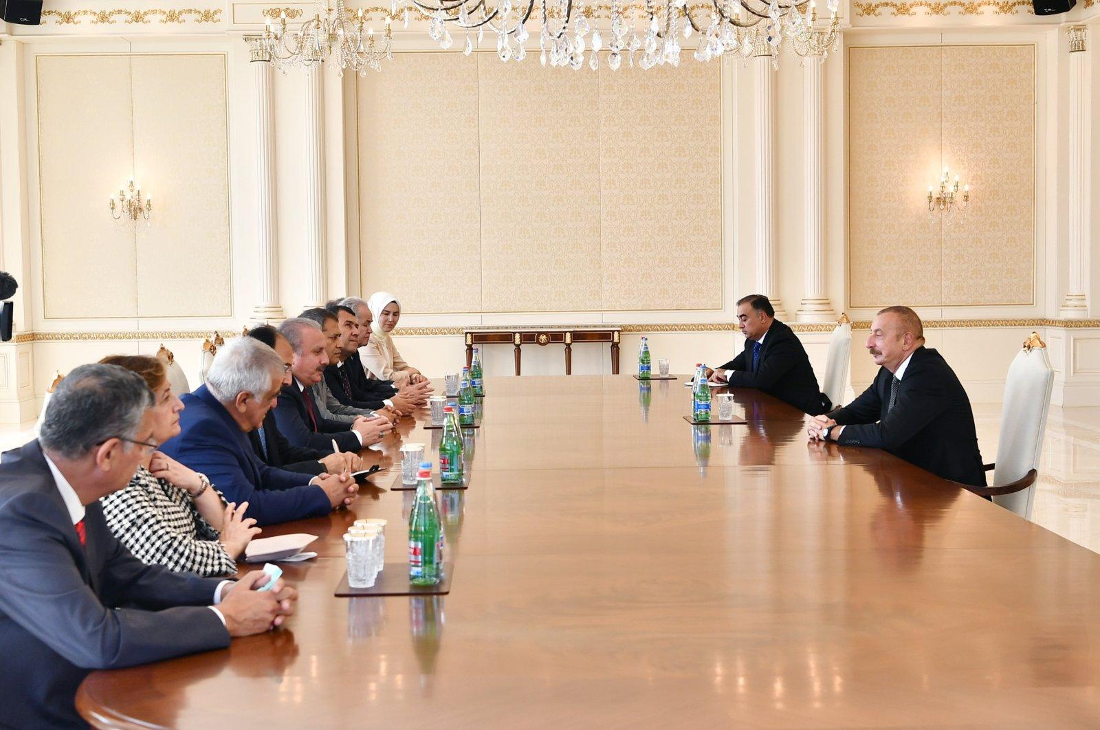 Azerbaijan's President Ilham Aliyev (R) receives Turkey's Parliament Speaker Mustafa Şentop (L-C) in the Zagulba Palace, Baku, Azerbaijan, July 27, 2021. (AA Photo)