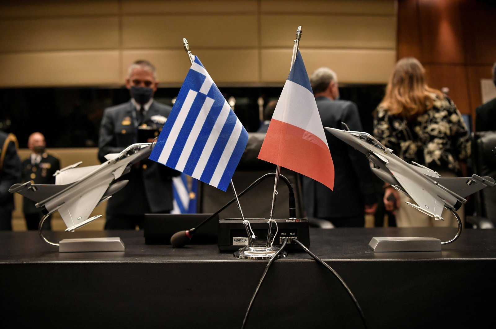 Models of Rafale jets are seen next to Greek and French national flags before the signing of an agreement for the purchase of 18 Dassault-made Rafale fighter jets at the Greek Defence Ministry in Athens, Greece, January 25, 2021. (Reuters Photo)