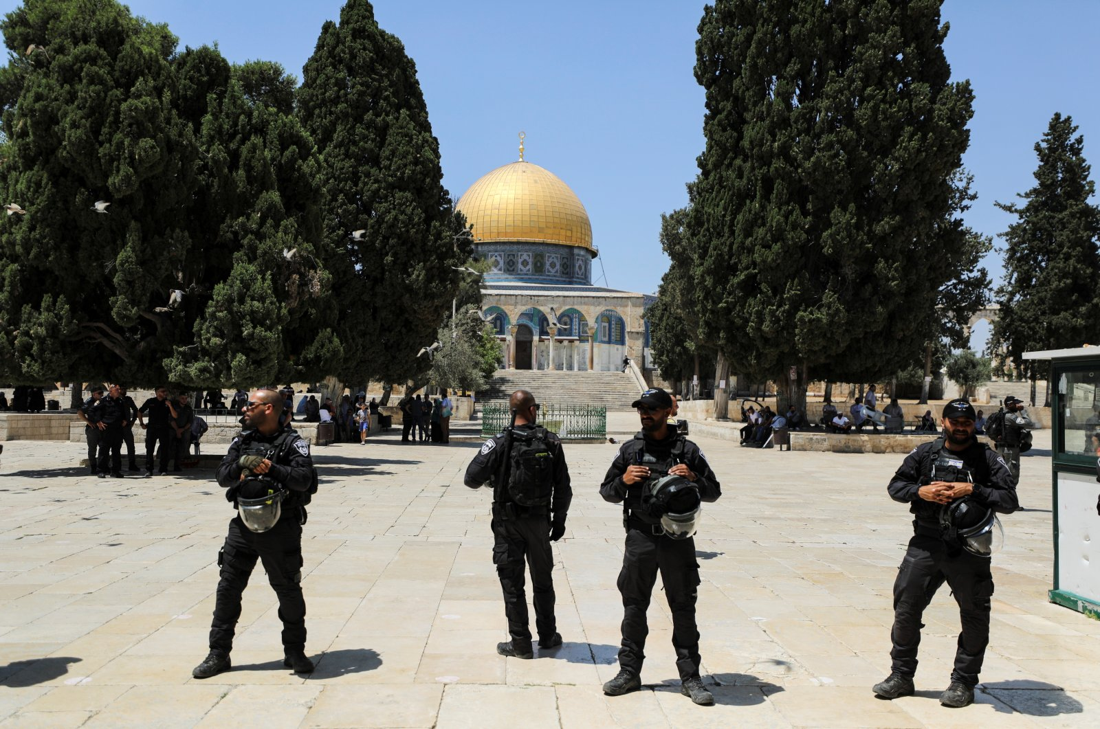 The Dome of the Rock is seen in the background as Israeli security forces stand guard after brief clashes erupted between Israeli police and Palestinians at Al-Aqsa Mosque in East Jerusalem, occupied Palestine, July 18, 2021. (Reuters Photo)
