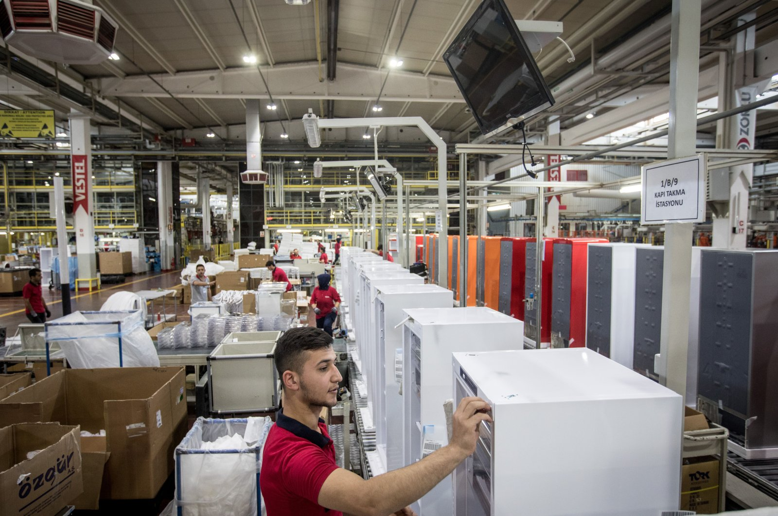 Employees work on a refrigerator production line in the Vestel City mega factory in the western Manisa province, Turkey, May 14, 2018. (Getty Images)