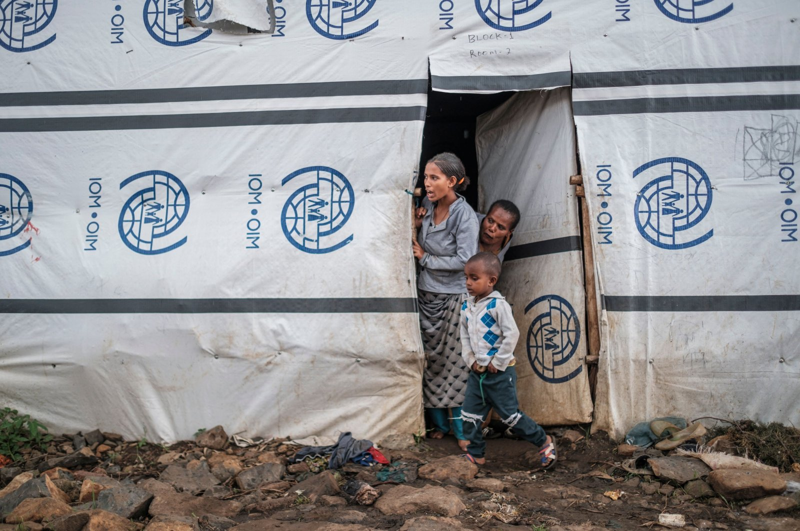 Internally displaced people stand at the door of a shelter at a camp in Azezo, Ethiopia, July 12, 2021. (AFP Photo)