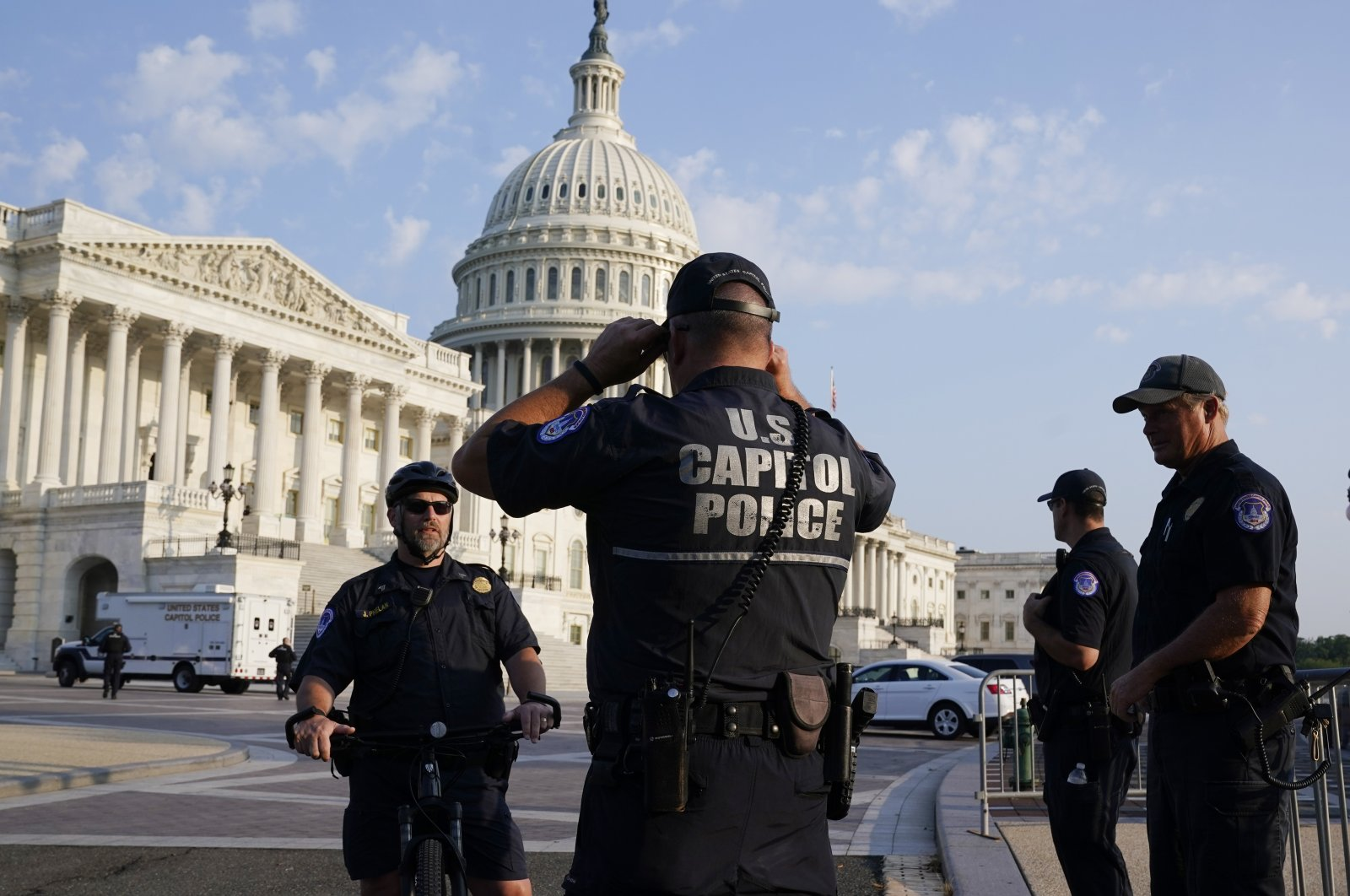 The U.S. Capitol is seen in Washington, early Tuesday as U.S. Capitol Police watch the perimeter, Washington, U.S., July 27, 2021. (AP Photo)