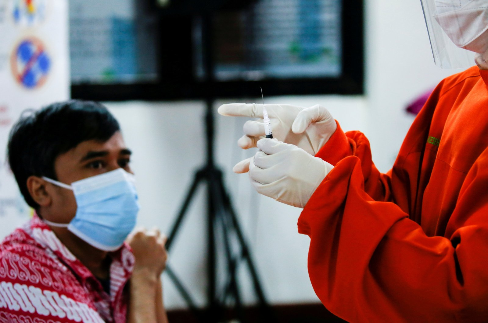 A health care worker prepares to administer a dose of the Sinovac vaccine at a district health facility in Jakarta, Indonesia, Jan. 14, 2021. (Reuters Photo)