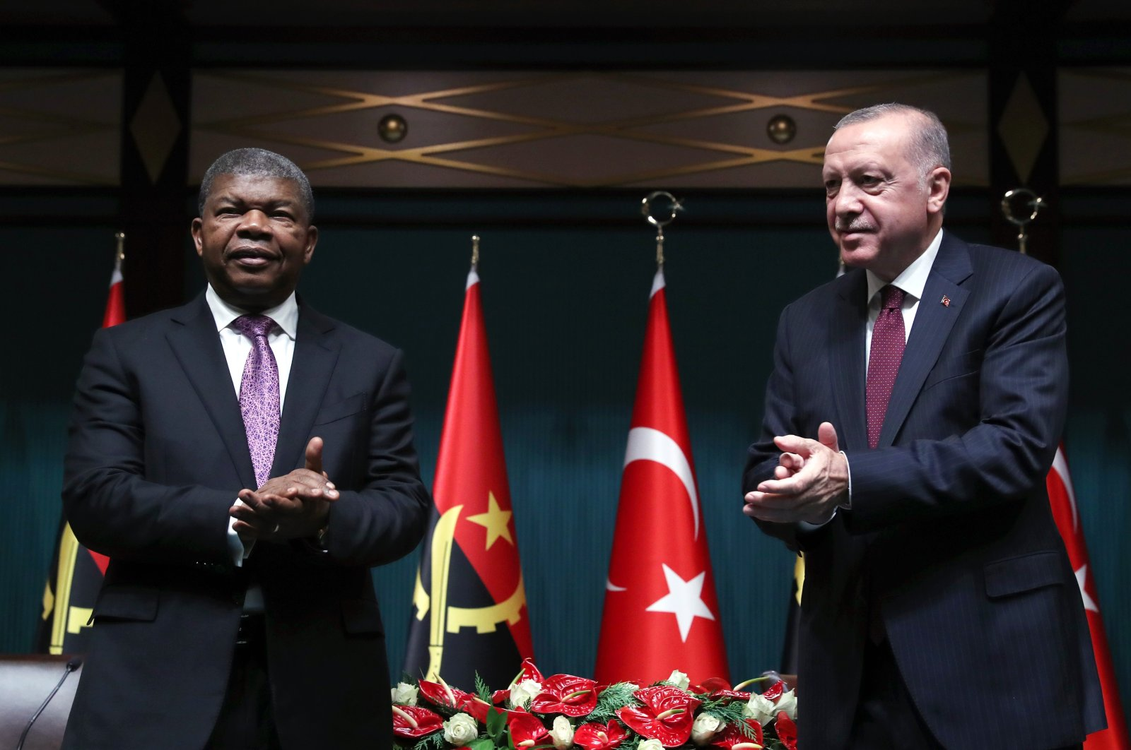 President Recep Tayyip Erdoğan (R) and his Angolan counterpart João Manuel Gonçalves Lourenço applaud after a bilateral agreement was signed at the Presidential Complex in Ankara, Turkey on July 27, 2021 (AA Photo)