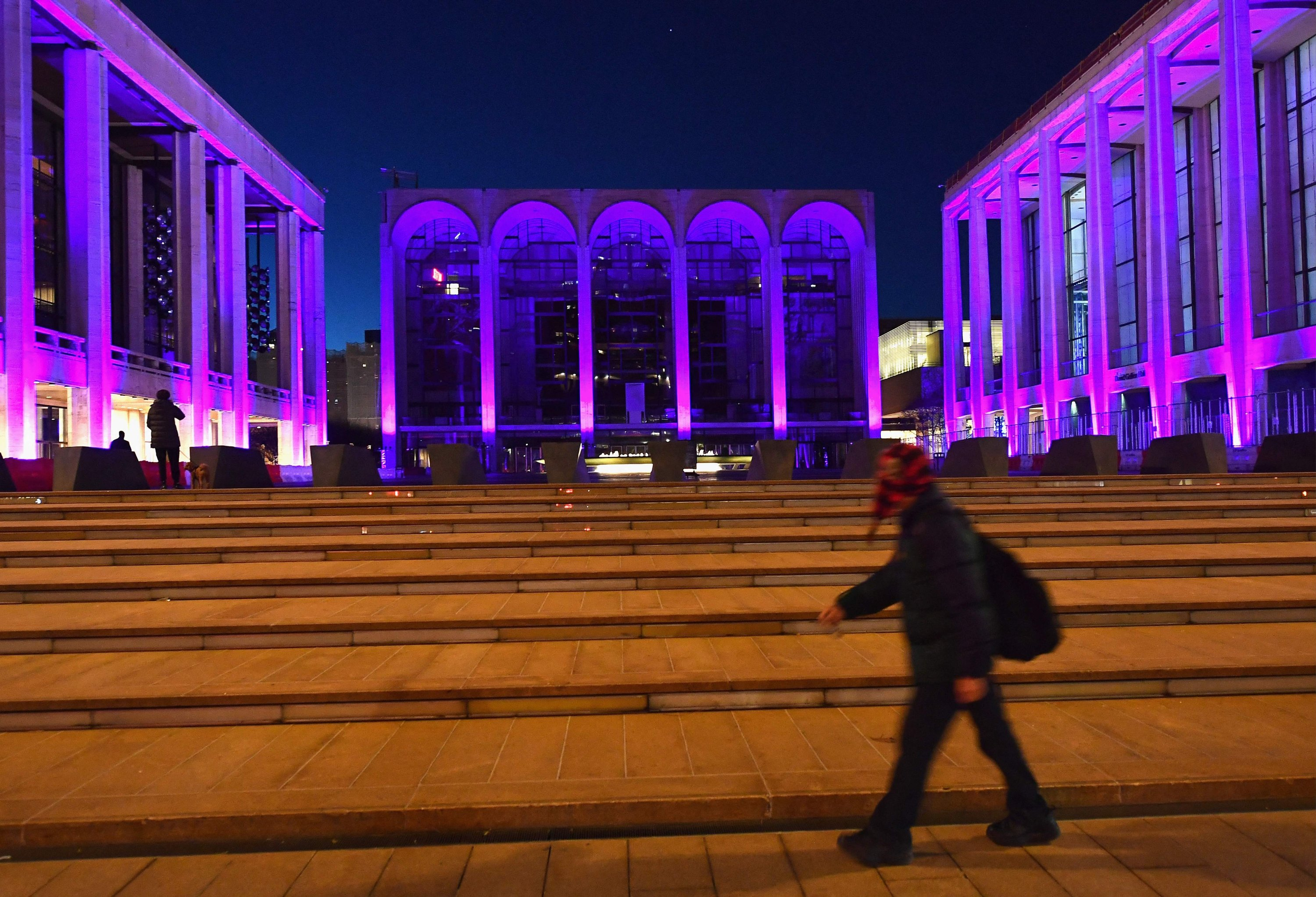 A person walks past the closed Metropolitan Opera at Lincoln Center in New York City, January 7, 2021 (AFP File Photo)