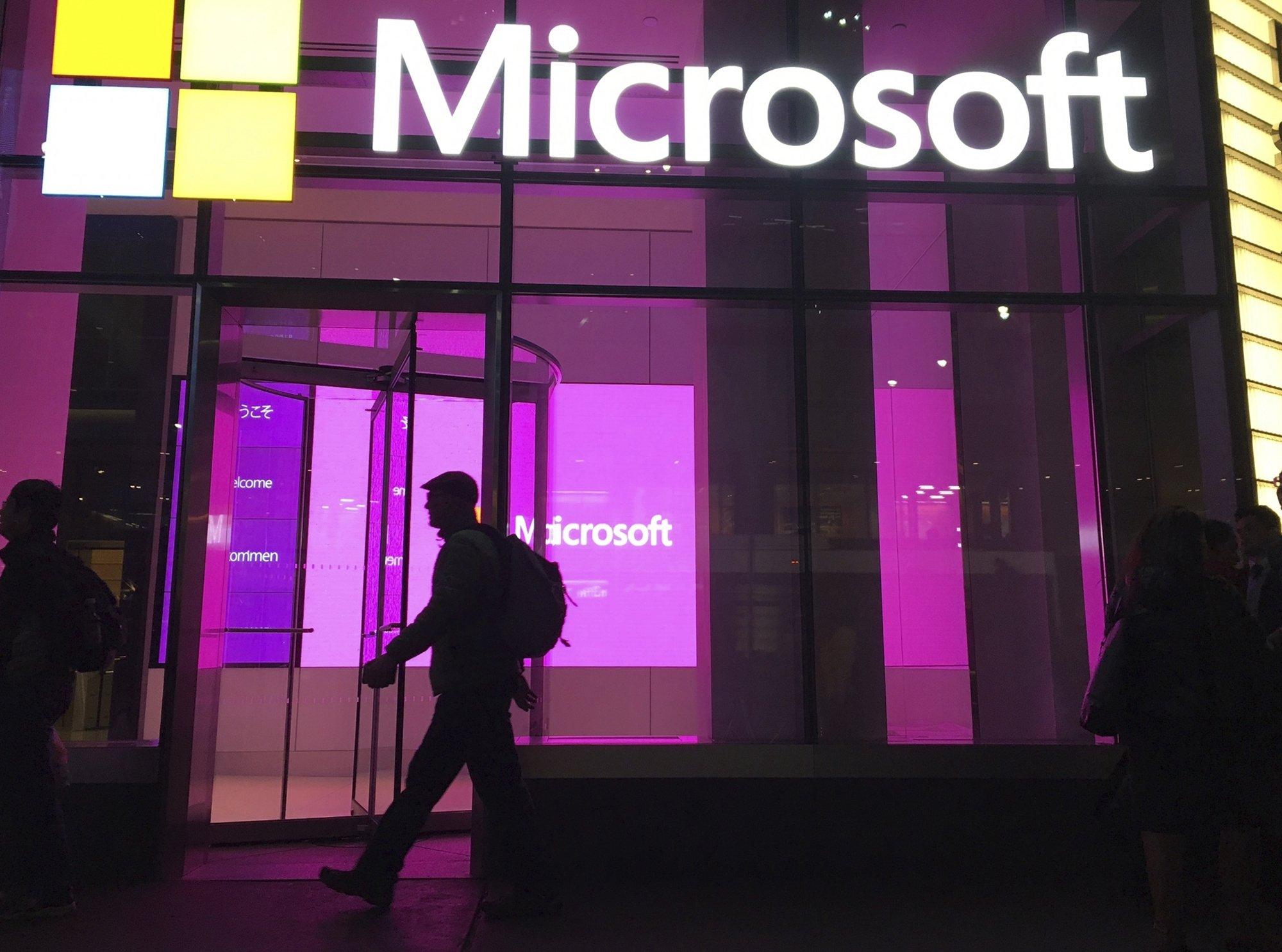 People walk past a Microsoft office in New York, U.S., Nov. 10, 2016. (AP Photo)