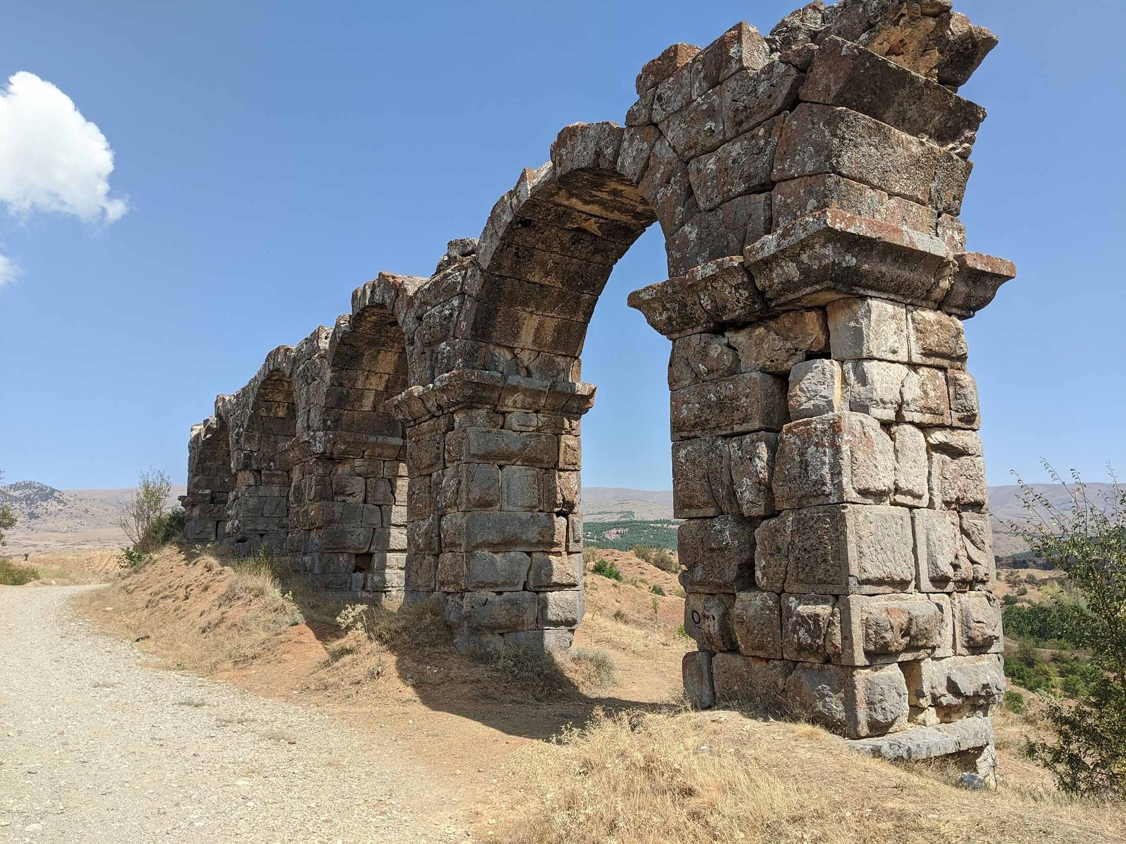 An ancient Roman aqueduct leading to the city of Antioch built by Emperor Trajan in the 2nd century A.D., stands outside modern-day Hatay, Turkey. (Shutterstock Photo)