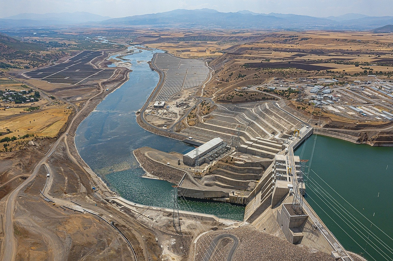 A dam builtover the Murat River and a hydroelectric power plant are seen in the eastern Bingöl province, Turkey, July 27, 2021. (IHA Photo)