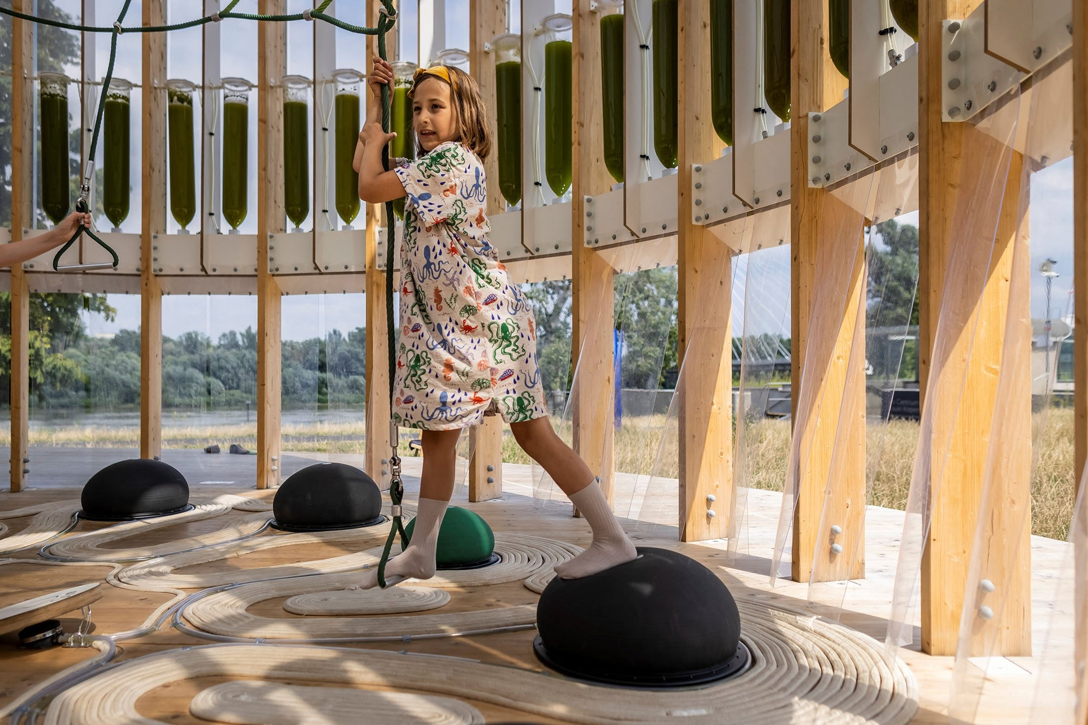 Nine-year-old Anielka plays in an AirBubble, an innovative playground providing clean air thanks to algae that absorbs pollutants and CO2, in Warsaw, Poland, July 26, 2021. (AFP Photo)