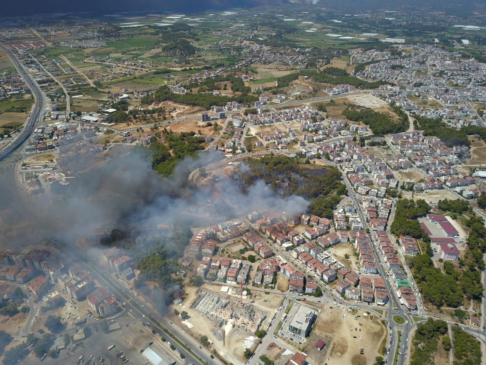 An aerial view of the fire in the early hours of the blaze, in Manavgat district, in Antalya, southern Turkey, July 28, 2021. (DHA PHOTO)