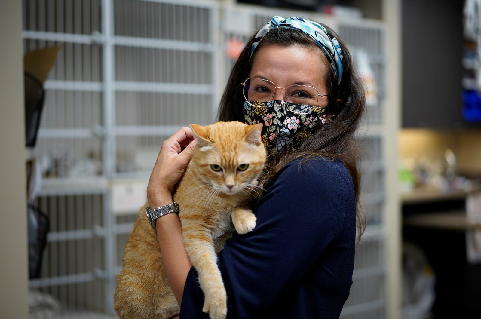 Miche Priest, venture lead of Alta ML, with a cat at the Wild Rose Cat clinic in Calgary, Alberta, Canada, July 14, 2021. (Reuters Photo)