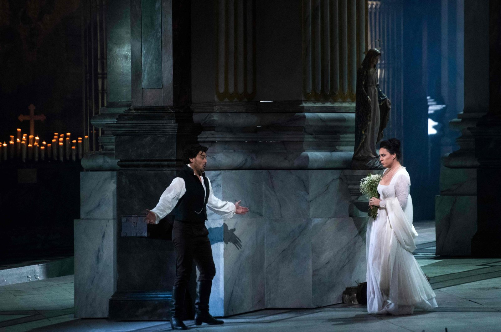"""Sonya Yoncheva, who plays the title role of the fiery diva, and Vittorio Grigolo, who plays her passionate lover, Cavaradossi, perform in """"Tosca"""" at the Metropolitan Opera, New York City, January 23, 2018. (AFP File Photo)"""