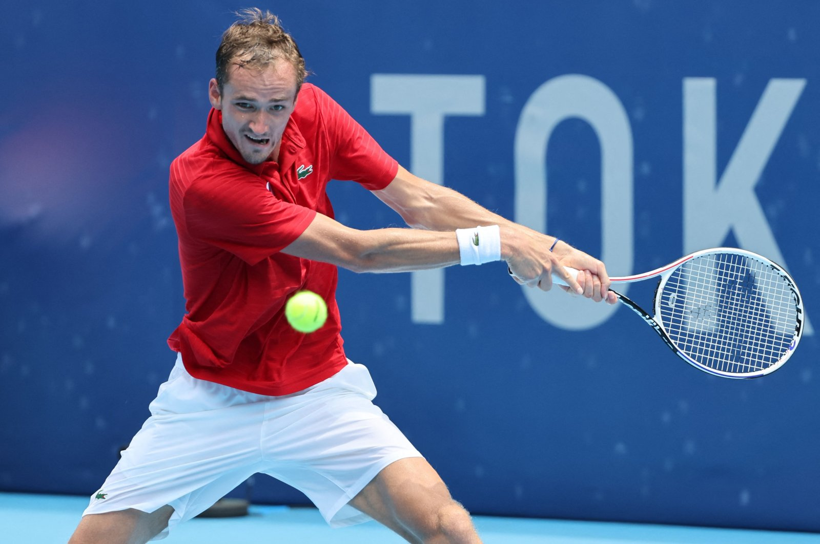 Russia's Daniil Medvedev returns the ball to Italy's Fabio Fognini during their Tokyo 2020 Olympic Games men's singles third round tennis match at the Ariake Tennis Park in Tokyo, Japan, July 28, 2021. (AFP Photo)