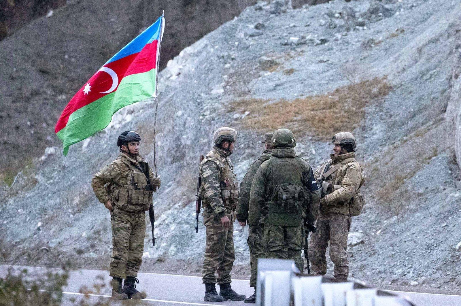 Russian peacekeepers and Azerbaijani servicemen near the village of Dadivank, Kalbajar district, Azerbaijan, Nov. 25, 2020 (Getty Images)
