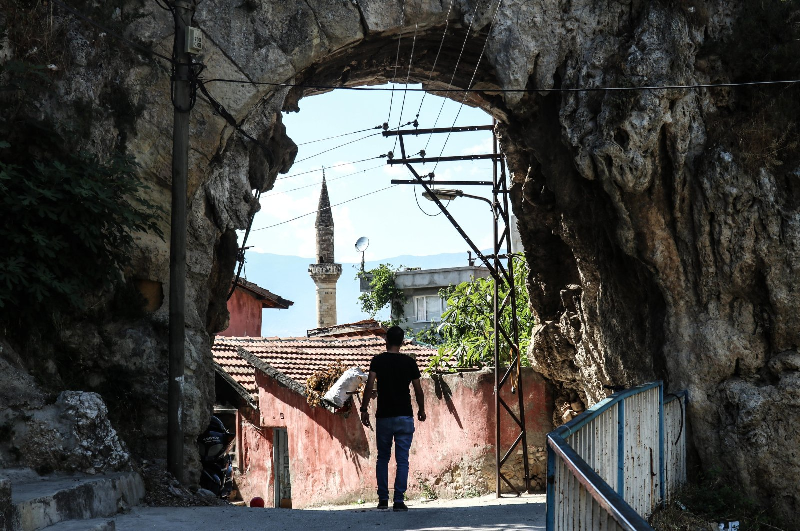 A man walks under the arch of an aqueduct in Hatay, Turkey, July 27, 2021. (AA Photo).