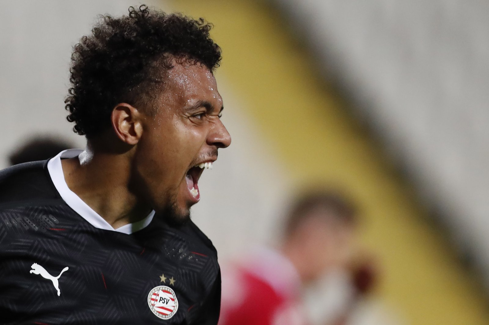 PSV's Donyell Malen celebrates his second goal against Omonia during the Europa League Group E match at GSP stadium in Nicosia, Cyprus, Oct. 29, 2020. (AP Photo)
