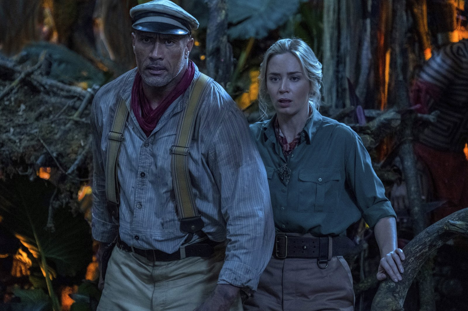 """Emily Blunt, right, and Dwayne Johnson in a scene from """"Jungle Cruise."""" (Disney via AP)"""