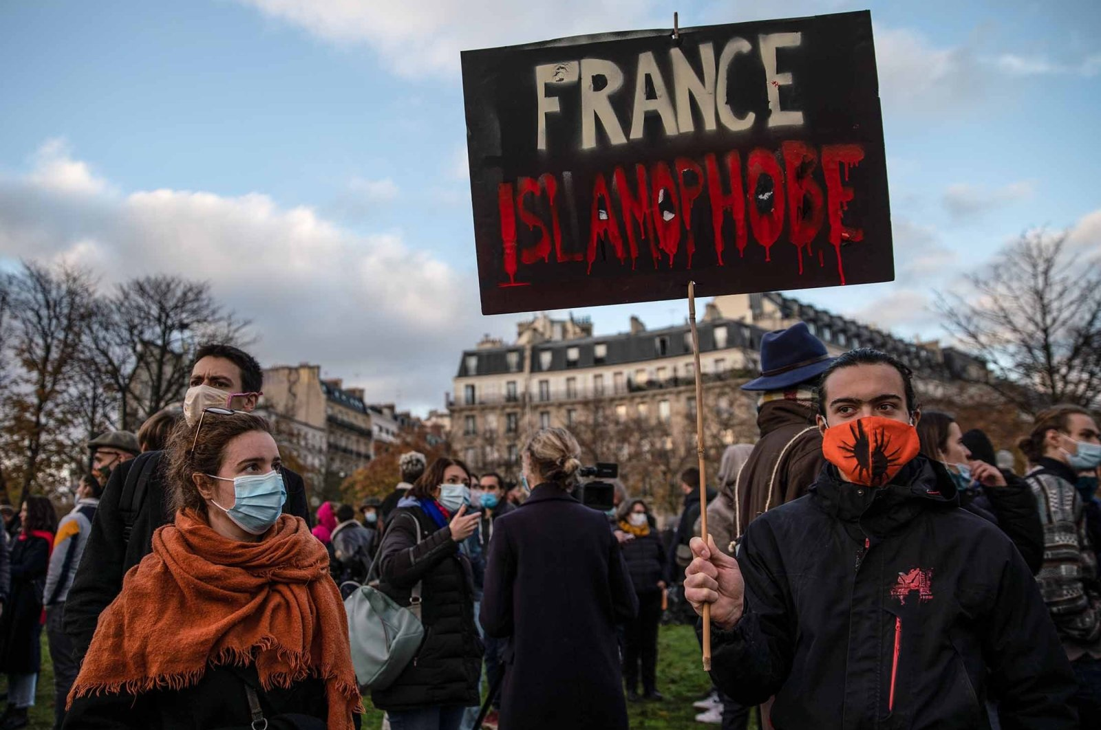 A protestor holds a placard that reads 'France Islamophobe' during a demonstration against the French government's global security bill and restrictions that target Muslim communities, Paris, France, Nov. 21, 2020. (Getty Images)