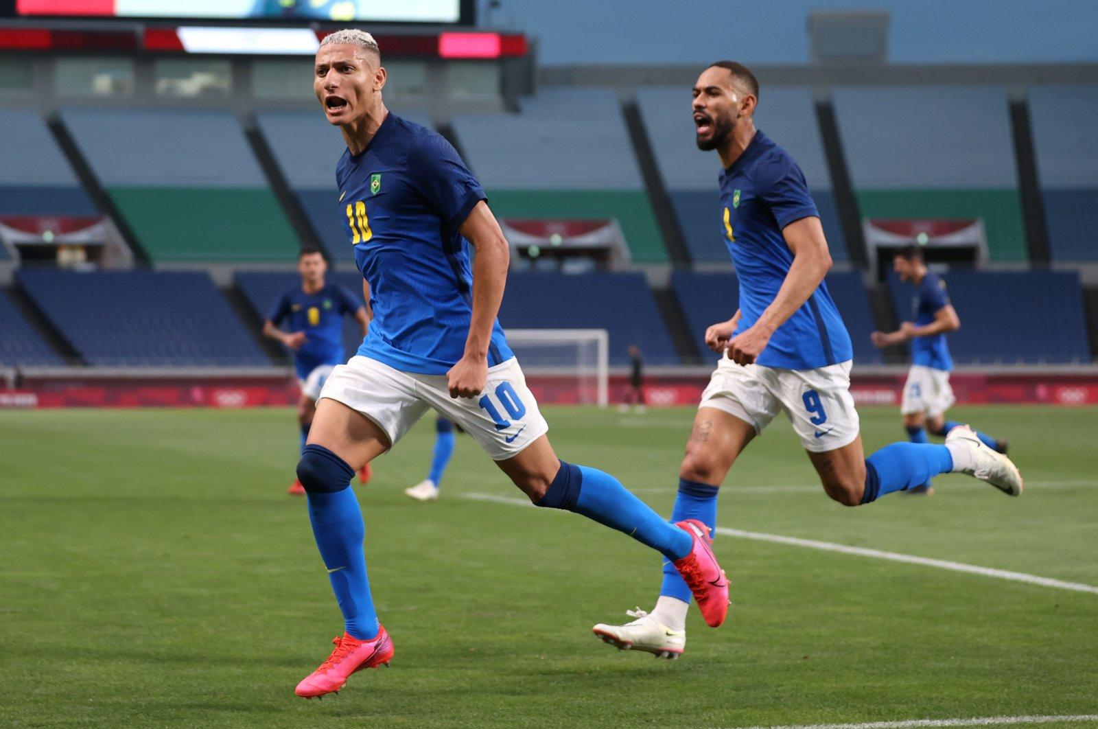 Brazil's Richarlison celebrates scoring his team's second goal against Saudi Arabia during the Tokyo 2020 Olympics men's football tournament at Saitama Stadium, Saitama, Japan, July 28, 2021.